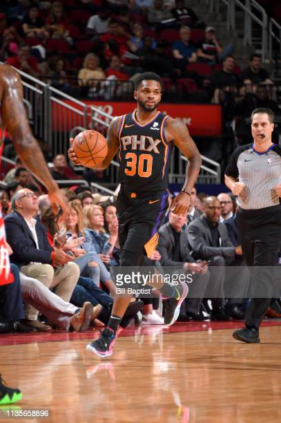 Troy Daniels of the Phoenix Suns handles the ball against the Houston Rockets on April 7 2019 at the Toyota Center in Houston Texas NOTE TO USER User...