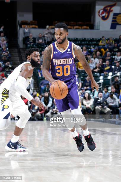 Troy Daniels of the Phoenix Suns handles the ball against the Indiana Pacers on January 15 2019 at Bankers Life Fieldhouse in Indianapolis Indiana...