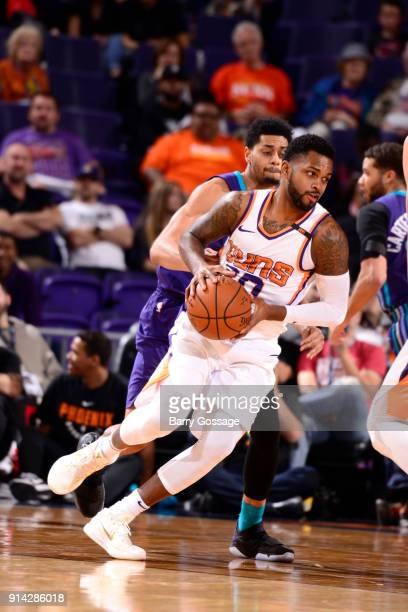 Troy Daniels of the Phoenix Suns handles the ball against the Charlotte Hornets on February 4 2018 at Talking Stick Resort Arena in Phoenix Arizona...