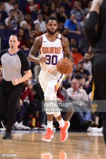 Troy Daniels of the Phoenix Suns handles the ball against the Cleveland Cavaliers on March 13 2018 at Talking Stick Resort Arena in Phoenix Arizona...