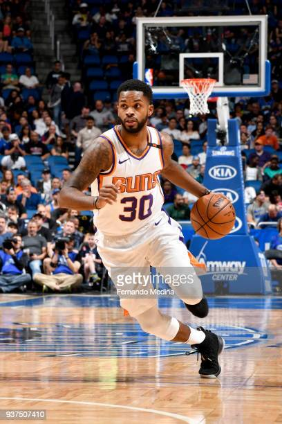 Troy Daniels of the Phoenix Suns handles the ball against the Orlando Magic on March 24 2018 at Amway Center in Orlando Florida NOTE TO USER User...
