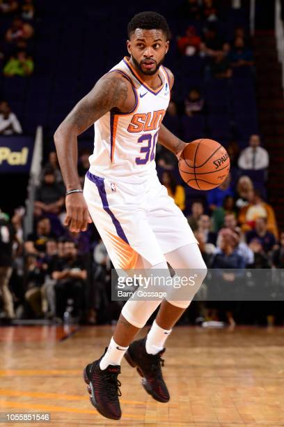 Troy Daniels of the Phoenix Suns handles the ball against the San Antonio Spurs on October 31 2018 at Talking Stick Resort Arena in Phoenix Arizona...