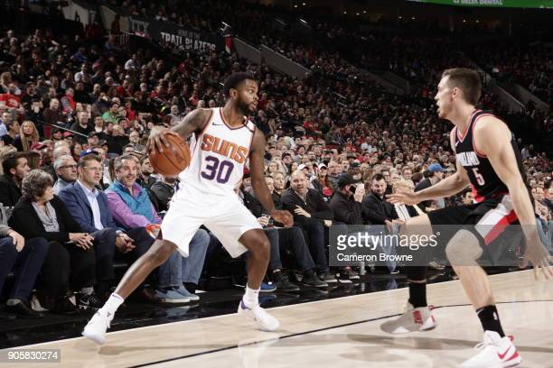 Troy Daniels of the Phoenix Suns handles the ball during the game against the Portland Trail Blazers on January 16 2018 at the Moda Center in...