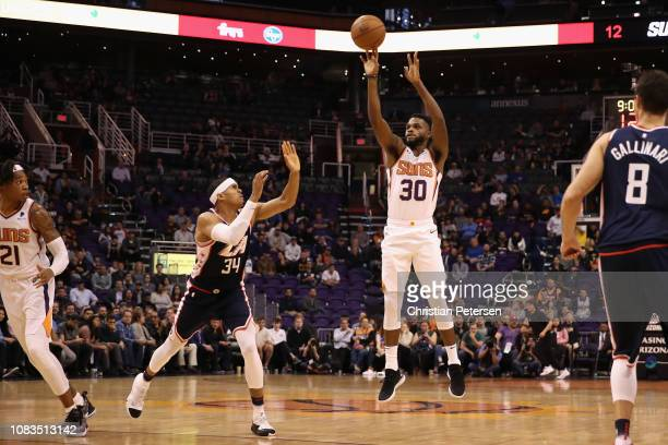 Troy Daniels of the Phoenix Suns shoots over Tobias Harris of the LA Clippers during the NBA game at Talking Stick Resort Arena on December 10 2018...