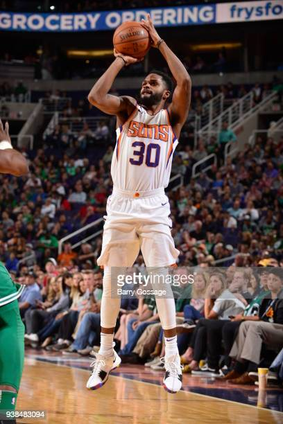 Troy Daniels of the Phoenix Suns shoots the ball against the Boston Celtics on March 26 2018 at Talking Stick Resort Arena in Phoenix Arizona NOTE TO...