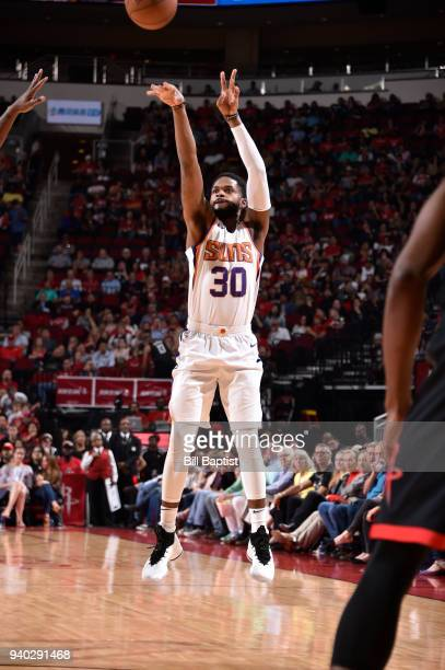 Troy Daniels of the Phoenix Suns shoots the ball against the Houston Rockets on March 30 2018 at the Toyota Center in Houston Texas NOTE TO USER User...