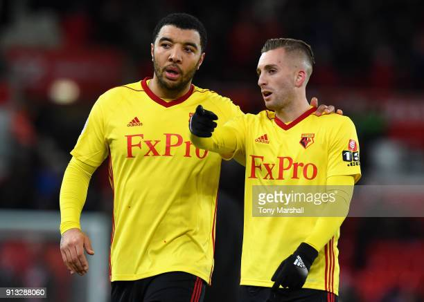 Troy Deeney and Gerard Deulofeu of Watford during the Premier League match between Stoke City and Watford at Bet365 Stadium on January 31 2018 in...