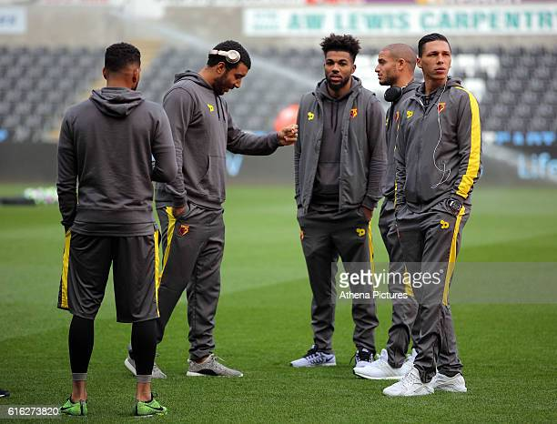 Troy Deeney and Jose Holebas of Watford with team mates walk onto the pitch prior to the Premier League match between Swansea City and Watford at The...