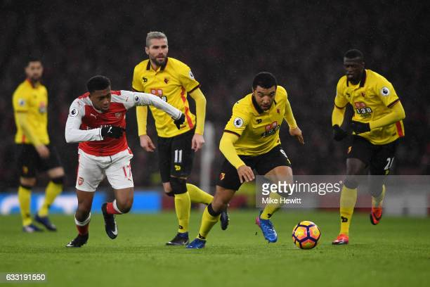 Troy Deeney of Watford and Alex Iwobi of Arsenal battle for the ball during the Premier League match between Arsenal and Watford at Emirates Stadium...
