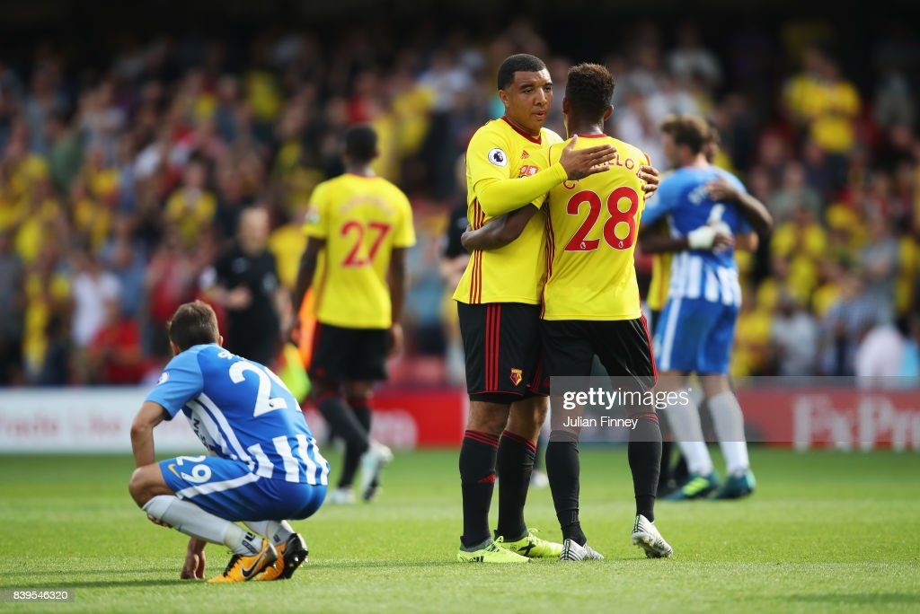 Troy Deeney of Watford and Andre Carrilo of Watford emrbrace after the Premier League match between Watford and Brighton and Hove Albion at Vicarage Road on August 26, 2017 in Watford, England.