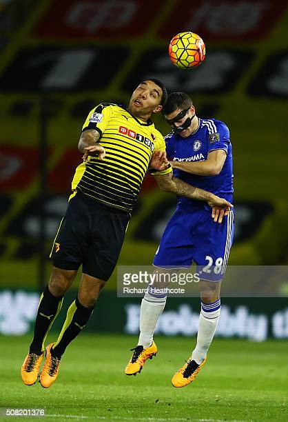 Troy Deeney of Watford and Cesar Azpilicueta of Chelsea compete for a header during the Barclays Premier League match between Watford and Chelsea at...