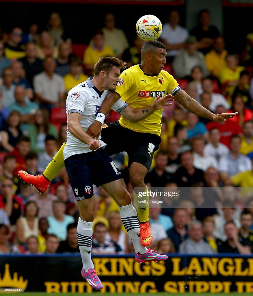 Troy Deeney of Watford and Dorian Dervite battle for the ball during the Sky Bet Championship match between Watford and Bolton Wanderers at Vicarage Road on August 9, 2014 in Watford, England.