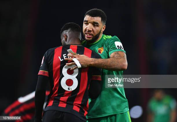 Troy Deeney of Watford and Jefferson Lerma of AFC Bournemouth embrace after the Premier League match between AFC Bournemouth and Watford FC at...