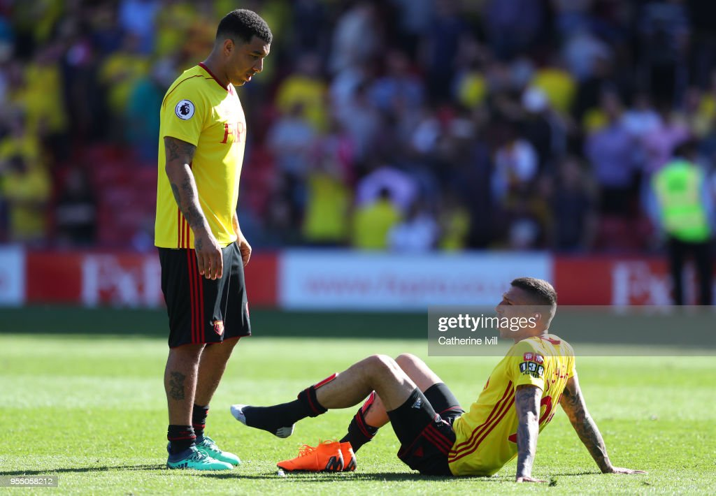 Troy Deeney of Watford and Jose Holebas of Watford during the Premier League match between Watford and Newcastle United at Vicarage Road on May 5, 2018 in Watford, England.