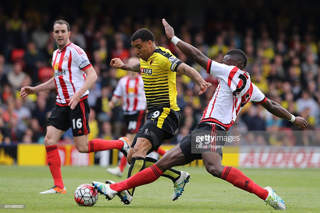 Troy Deeney of Watford and Lamine Kone of Sunderland compete for the ball during the Barclays Premier League match between Watford and Sunderland at Vicarage Road on May 15, 2016 in Watford, England.