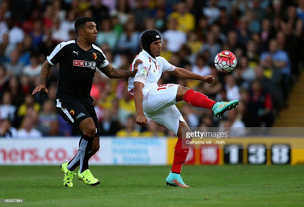 Troy Deeney of Watford and Luismi of Sevilla in action during the pre-season friendly between Watford and Seville at Vicarage Road on July 31, 2015 in Watford, England.