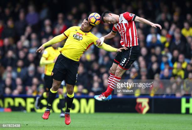 Troy Deeney of Watford and Maya Yoshida of Southampton battle to win a header during the Premier League match between Watford and Southampton at...