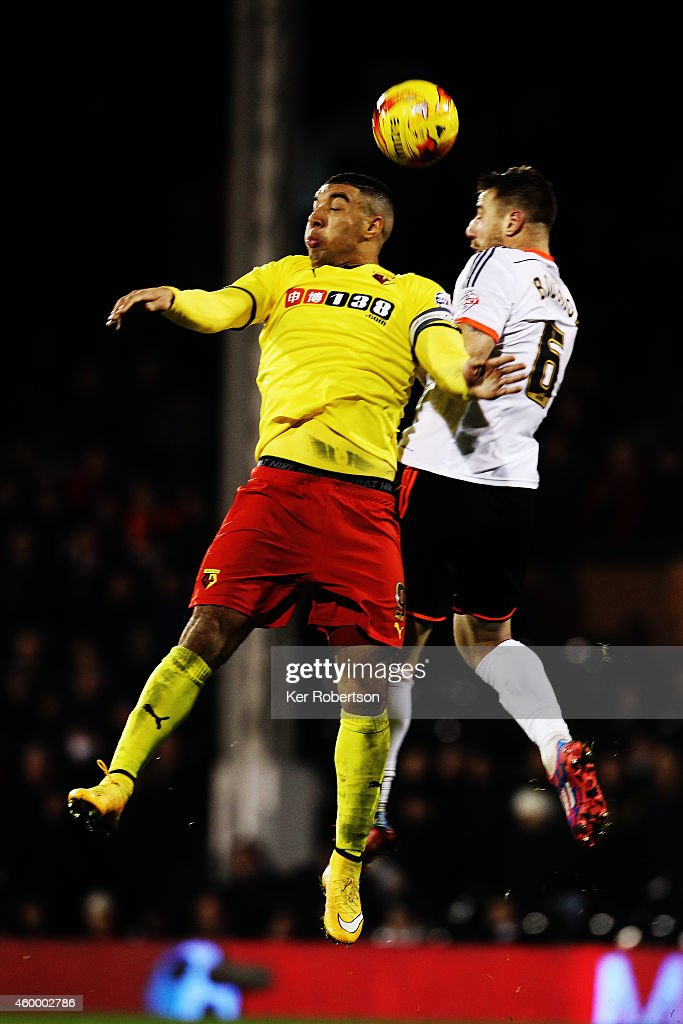 Troy Deeney of Watford and Nikolay Bodurov of Fulham challenge for the ball during the Sky Bet Championship match between Fulham and Watford at Craven Cottage on December 5, 2014 in London, England.