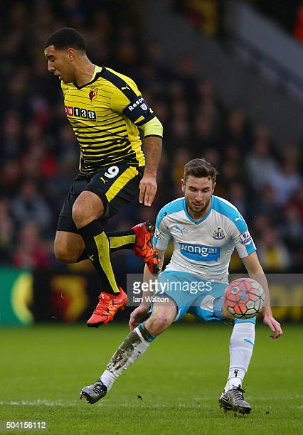 Troy Deeney of Watford and Paul Dummett of Newcastle United compete for the ball during the Emirates FA Cup Third Round match between Watford and...