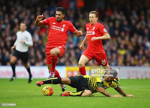 Troy Deeney of Watford battles with Emre Can and Lucas Leiva of Liverpool during the Barclays Premier League match between Watford and Liverpool at...
