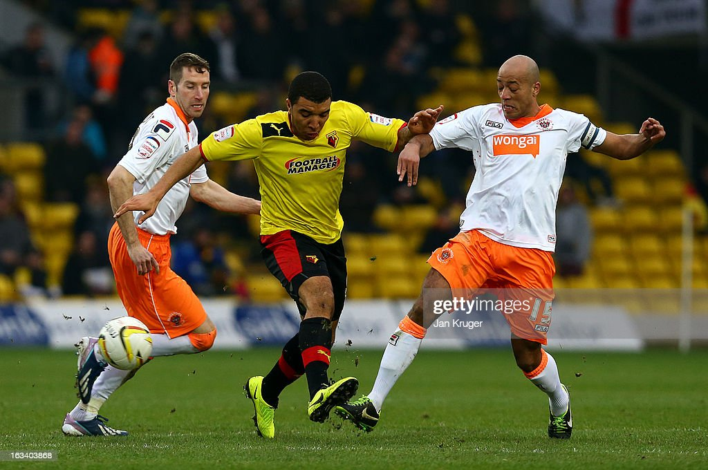 Troy Deeney of Watford battles with Kirk Broadfoot and Alex John-Baptiste of Blackpool during the npower Champions match between Watford and Blackpool at Vicarage Road on March 9, 2013 in Watford, England.