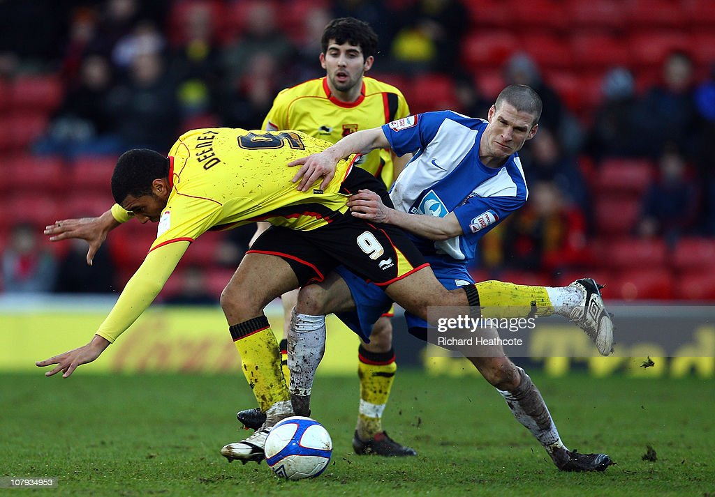 Troy Deeney of Watford battles with Paul Murray of Hartlepool during the 3rd round FA Cup Sponsored by E.ON match between Watford and Hartlepool United at Vicarage Road on January 8, 2011 in Watford, England.