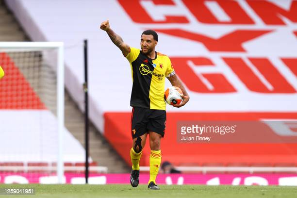 Troy Deeney of Watford celebrates after scoring his sides first goal from the penalty spot during the Premier League match between Arsenal FC and...