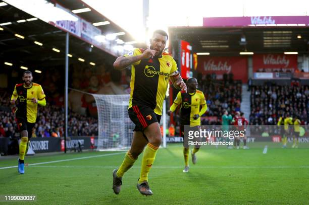 Troy Deeney of Watford celebrates after scoring his sides second goal during the Premier League match between AFC Bournemouth and Watford FC at...