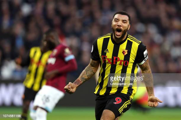 Troy Deeney of Watford celebrates after scoring his team's first goal during the Premier League match between West Ham United and Watford FC at...