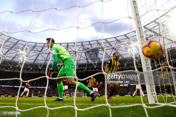 Troy Deeney of Watford celebrates after scoring his team's first goal past Lukasz Fabianski of West Ham United during the Premier League match...