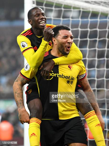 Troy Deeney of Watford celebrates after scoring his team's first goal with Abdoulaye Doucoure of Watford during the Premier League match between...