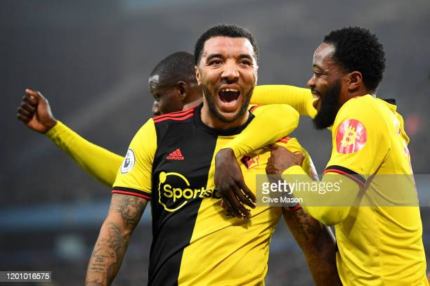 Troy Deeney of Watford celebrates after scoring his team's first goal with Nathaniel Chalobah and Abdoulaye Doucoure of Watford during the Premier...