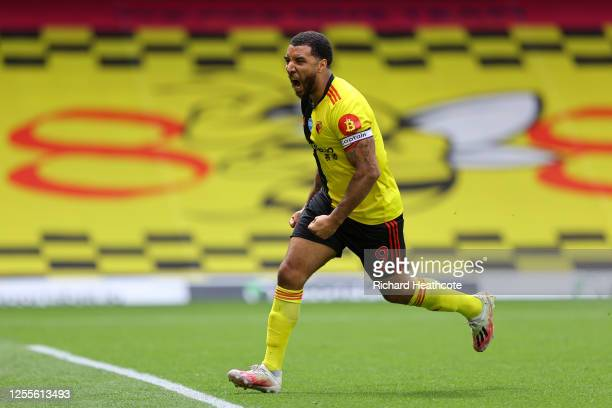 Troy Deeney of Watford celebrates after scoring his team's first goal from a penalty during the Premier League match between Watford FC and Newcastle...