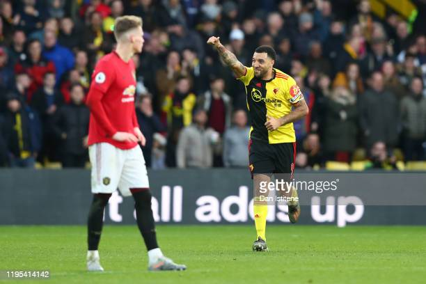 Troy Deeney of Watford celebrates after scoring his team's second goal from the penalty spot during the Premier League match between Watford FC and...