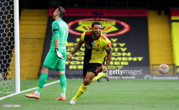 Troy Deeney of Watford celebrates after scoring his team's second goal from a penalty during the Premier League match between Watford FC and...