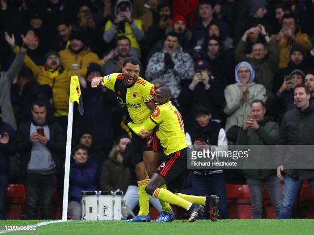Troy Deeney of Watford celebrates after scoring his team's third goal with teammate Abdoulaye Doucoure during the Premier League match between...