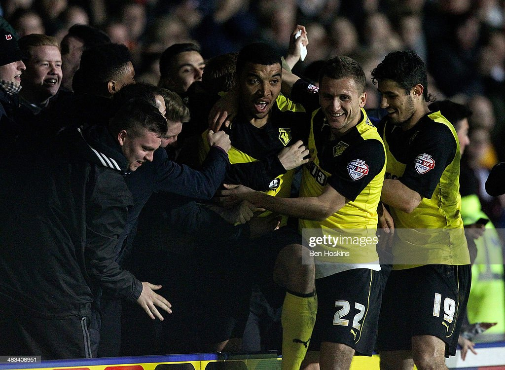 Troy Deeney of Watford celebrates after scoring his team's third goal of the game during the Sky Bet Championship match between Watford and Leeds United at Vicarage Road on April 8, 2014 in Watford, England.