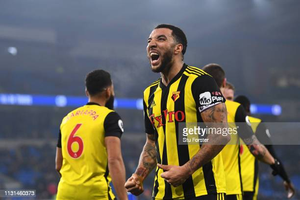 Troy Deeney of Watford celebrates as he scores his team's fifth goal during the Premier League match between Cardiff City and Watford FC at Cardiff...