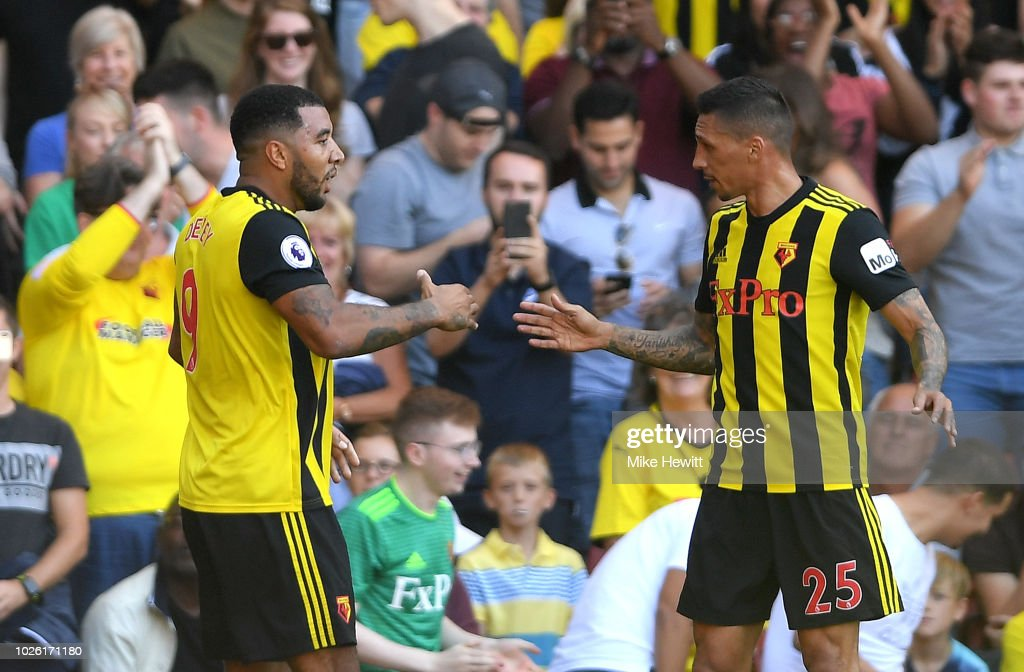 Troy Deeney of Watford (9) celebrates as he scores his team's first goal with Jose Holebas of Watford (25) during the Premier League match between Watford FC and Tottenham Hotspur at Vicarage Road on September 2, 2018 in Watford, United Kingdom.