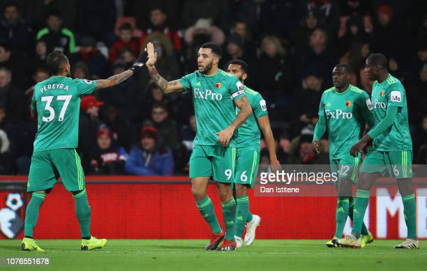 Troy Deeney of Watford celebrates as he scores his team's second goal with Roberto Pereyra and team mates during the Premier League match between AFC...