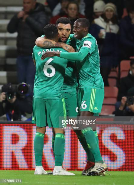 Troy Deeney of Watford celebrates as he scores his team's second goal with Adrian Mariappa and Abdoulaye Doucoure during the Premier League match...