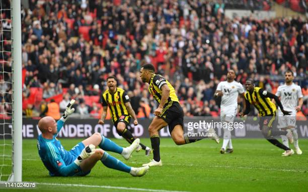 Troy Deeney of Watford celebrates as he scores his team's second goal from a penalty as John Ruddy of Wolverhampton Wanderers reacts during the FA...