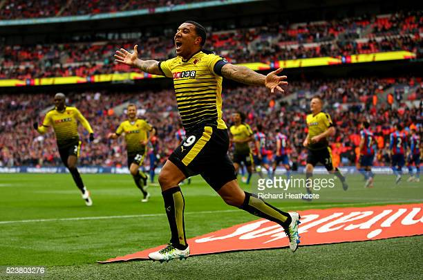 Troy Deeney of Watford celebrates as he scores their first and equalising goal during The Emirates FA Cup semi final match between Watford and...
