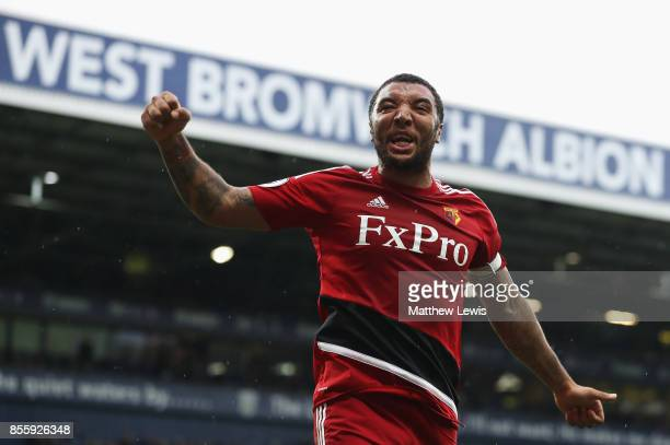 Troy Deeney of Watford celebrates his side's second goal scored by Richarlison de Andrade during the Premier League match between West Bromwich...