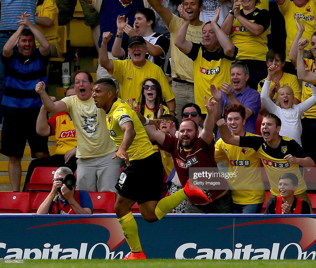 Troy Deeney of Watford celebrates in front of fans after scoring the opening goal during the Sky Bet Championship match between Watford and Bolton Wanderers at Vicarage Road on August 9, 2014 in Watford, England.