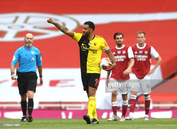 Troy Deeney of Watford celebrates scoring his sides first goal during the Premier League match between Arsenal FC and Watford FC at Emirates Stadium...