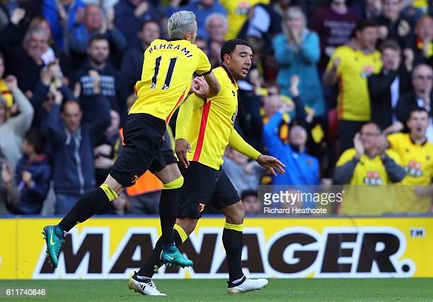 Troy Deeney of Watford celebrates scoring his sides first goal during the Premier League match between Watford and AFC Bournemouth at Vicarage Road...