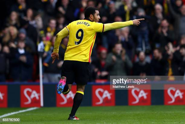 Troy Deeney of Watford celebrates scoring his sides first goal during the Premier League match between Watford and Burnley at Vicarage Road on...