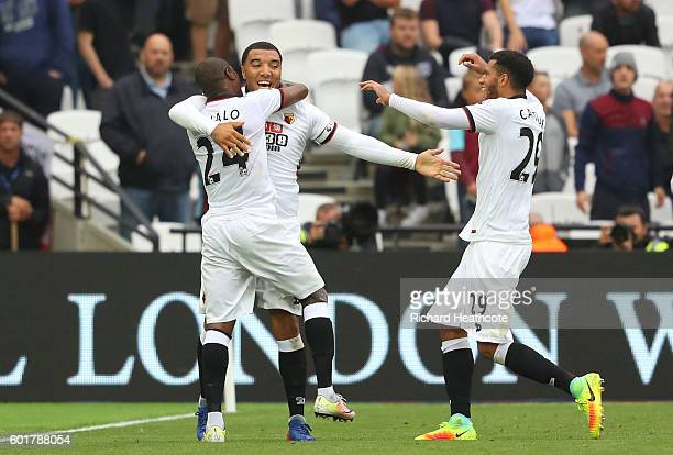 Troy Deeney of Watford celebrates scoring his sides first goal with Odion Ighalo of Watford during the Premier League match between West Ham United...