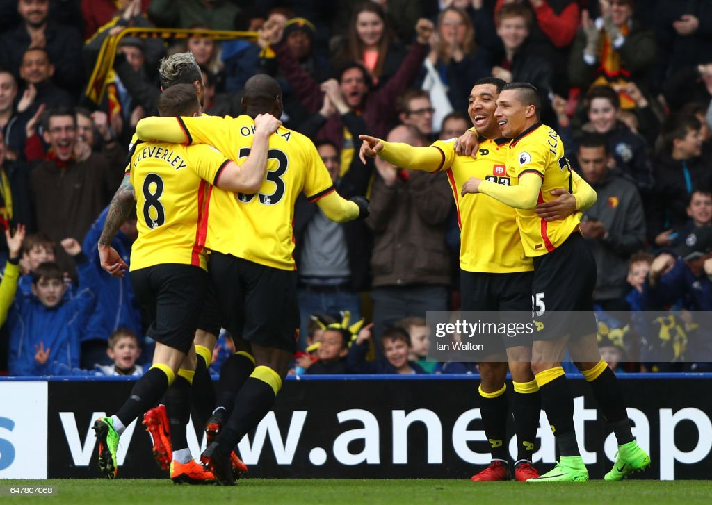Troy Deeney of Watford (CR) celebrates scoring his sides first goal with his Watford team mates during the Premier League match between Watford and Southampton at Vicarage Road on March 4, 2017 in Watford, England.
